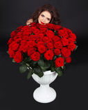 Girl portrait. Bouquet of red roses brunch. Valentine day. Dark Royalty Free Stock Photos