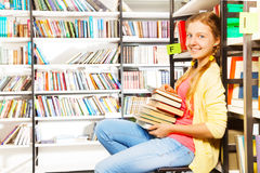 Girl portrait with 2 braids and pile of books Royalty Free Stock Photos