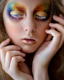 Girl portrait with creative colorful rainbow makeup Stock Photos