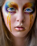 Girl portrait with creative colorful rainbow makeup stock images