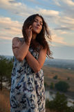 Girl portrait on evening plain background Royalty Free Stock Photography