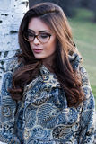 Girl portrait with eyeglasses and scarf outdoor Royalty Free Stock Photography