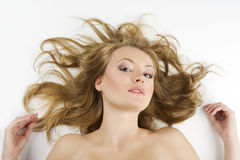 Girl portrait laying on white Royalty Free Stock Photo