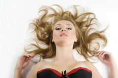 Girl portrait laying on white Royalty Free Stock Images