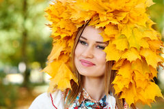 Girl portrait with leaves on head in autumn Stock Photo