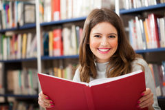 Girl portrait in a library Royalty Free Stock Photo