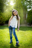 Girl Portrait. The portrait of a little girl in the garden Royalty Free Stock Photo