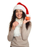 Girl portrait with little gift box in santa hat, posing on white background, christmas holiday concept, happy and emotions Stock Photography