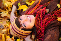 Girl portrait lying in leaves. Royalty Free Stock Image