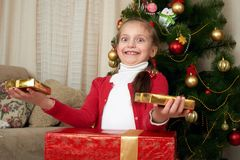 Girl portrait near christmas tree, decoration and gifts, winter holiday concept Royalty Free Stock Image