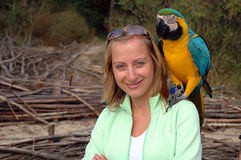 Girl portrait with parrot. Girl portrait at the beach  with parrot Royalty Free Stock Image