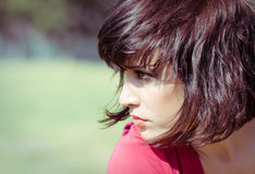 Girl is portrait into the profile on nature. Royalty Free Stock Photos