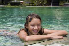 Girl portrait relaxing in swimming pool Royalty Free Stock Photography