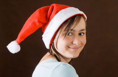 Girl portrait in santa claus hat Stock Image