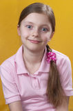 Girl portrait. Schoolgirl portrait over yellow backgroind Royalty Free Stock Images