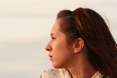 Girl portrait. Sideview. Portrait of young girl staring at the sunset Royalty Free Stock Photo