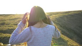 Girl portrait smile emotions in the sunset sunlight beams. Nature hils and field.  stock video