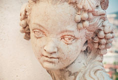 Girl portrait in stone. Copy of rustic antique sculpture Royalty Free Stock Images