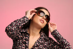 Girl portrait with sunglasses. Pink background Stock Photography