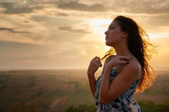 Girl portrait at sunset on plain background Stock Photography