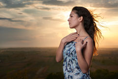 Girl portrait at sunset on plain background Royalty Free Stock Photography