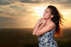 Girl portrait at sunset on plain background Royalty Free Stock Photo
