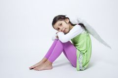 Girl portrait with wings. On white  background Royalty Free Stock Photography