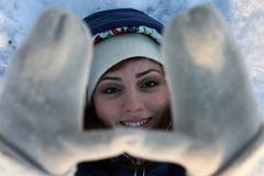 Girl portrait winter hand hide. Girl portrait in winter hand hide on a snow Royalty Free Stock Image