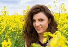 Girl portrait in yellow flower field Royalty Free Stock Photo