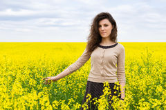 Girl portrait in yellow flower field Royalty Free Stock Photos