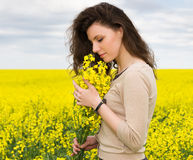 Girl portrait in yellow flower field Royalty Free Stock Photography