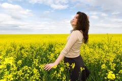 Girl portrait in yellow flower field Stock Photography