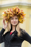 Girl portrait with yellow leaves on head Royalty Free Stock Images
