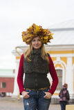Girl portrait with yellow leaves on head Royalty Free Stock Image