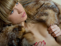 Girl portret in fur coat Royalty Free Stock Image