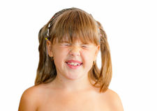 Girl poses face. Girl with pigtails poses, crooked teeth, eyes closed Stock Images
