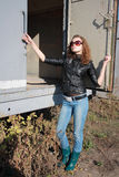 Girl poses near the iron trailer. Very beautiful girl poses near the iron trailer Stock Images