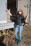 Girl poses near the iron trailer. Very beautiful girl poses near the iron trailer stock images
