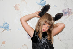 Girl poses with pair of black shoes. On her head Stock Photos