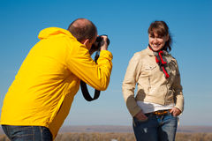 Girl poses for photographer on nature Stock Image
