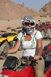 Girl poses on quad bike Royalty Free Stock Images