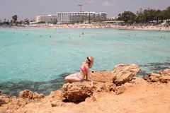 Girl poses on the coast of the Mediterranean Sea Stock Image