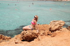 Girl poses on the coast of the Mediterranean Sea Stock Photography