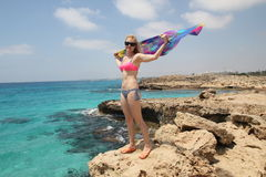Girl poses on the coast of the Mediterranean Sea Royalty Free Stock Image