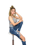 The girl poses sexy Sitting on a chair Royalty Free Stock Photos