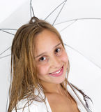 Girl poses with umbrella in studio Royalty Free Stock Images