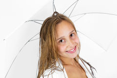 Girl poses with umbrella in studio Stock Photos