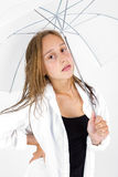 Girl poses with umbrella in studio Royalty Free Stock Photo
