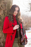 Girl poses with violin Stock Images