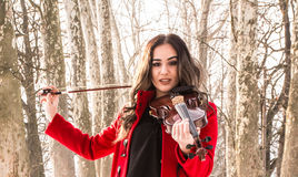 Girl poses with violin Royalty Free Stock Photos